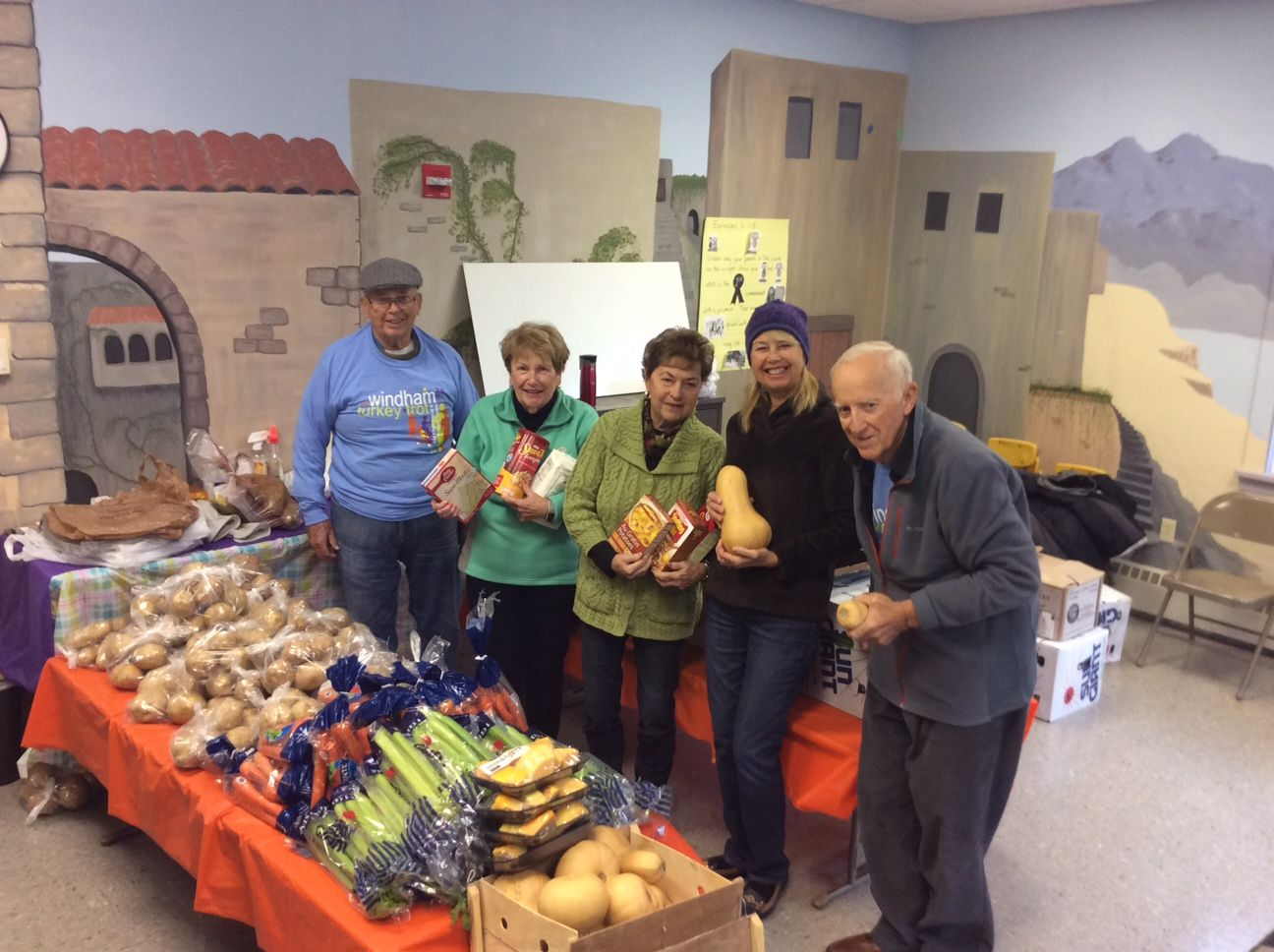 Volunteers with Thanksgiving Dinner fixings